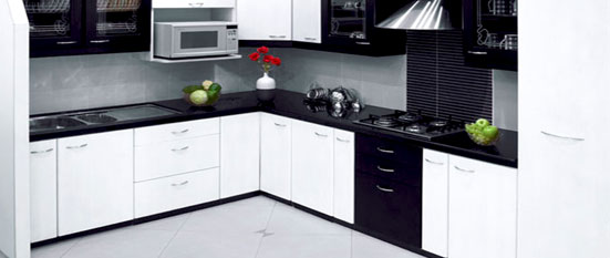 Black indian l shaped kitchen hyderabad interior designers for L shaped kitchen design ideas india